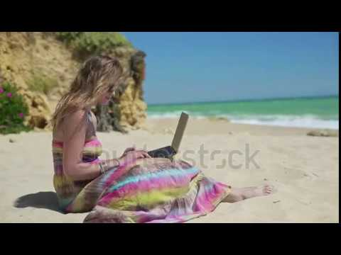e8b184f528 Young Woman Working On Laptop On Beautiful Beach Stock Footage Video  4165609 Shutterstock