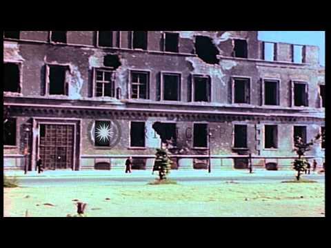 Brandenburg Gate and bomb damaged buildings along the Unter den Linden boulevard ...HD Stock Footage