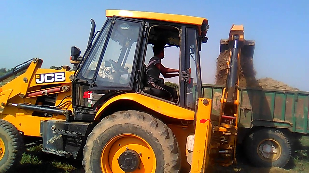 Jcb Machine Working In Open Field