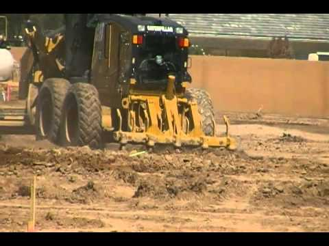 CAT 140M Motor Grader ripping and spinning tiers