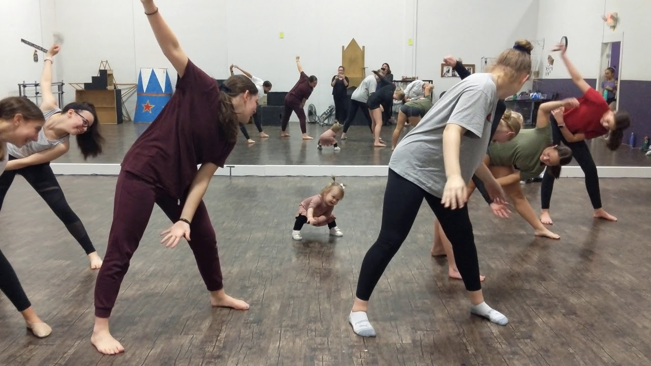Baby leads dance class warm up