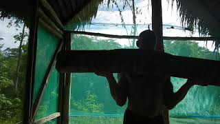front squats with log/wood. Training in the jungle