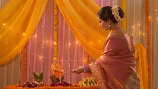 Young Indian woman in sari performing aarti of Lord Sai Baba - Festival concept. Temple in an Indian home