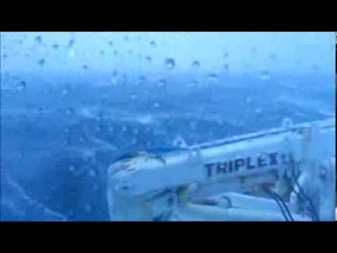 Boat crew tries to relax during heavy weather