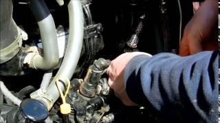 how to change fuel filter on mahindra 4035 tractor