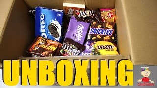 New a lot of candy man unboxing box full of sweets. Opening new candy box