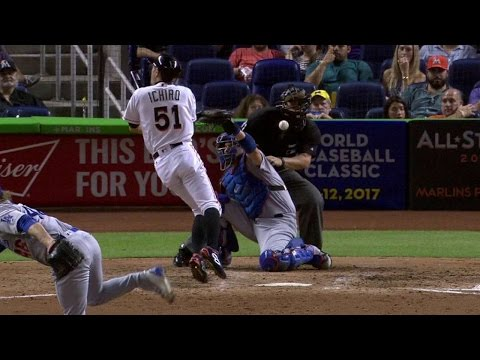 LAD@MIA: Ichiro gets hit by a pitch with bases loaded