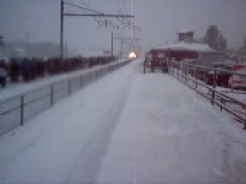 MBTA Commuter Rail arriving at Mansfield in the snow