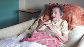 Spitz visits Joan at Osborne Grove