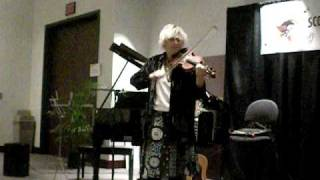 Darcie Deaville sings and plays the fiddle at the same time
