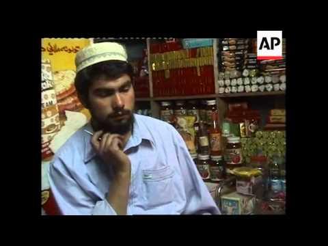 People listen to Taliban leader's radio address