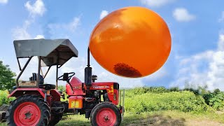 Biggest Monster Balloon VS Tractor - Experiment