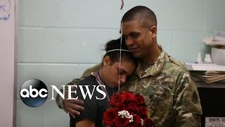 SOLIDER RETURNS HOME: Girl Surprised at School By Dad's Early Return From Kuwait