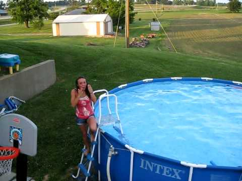 Bobby throwing Kyra in the pool