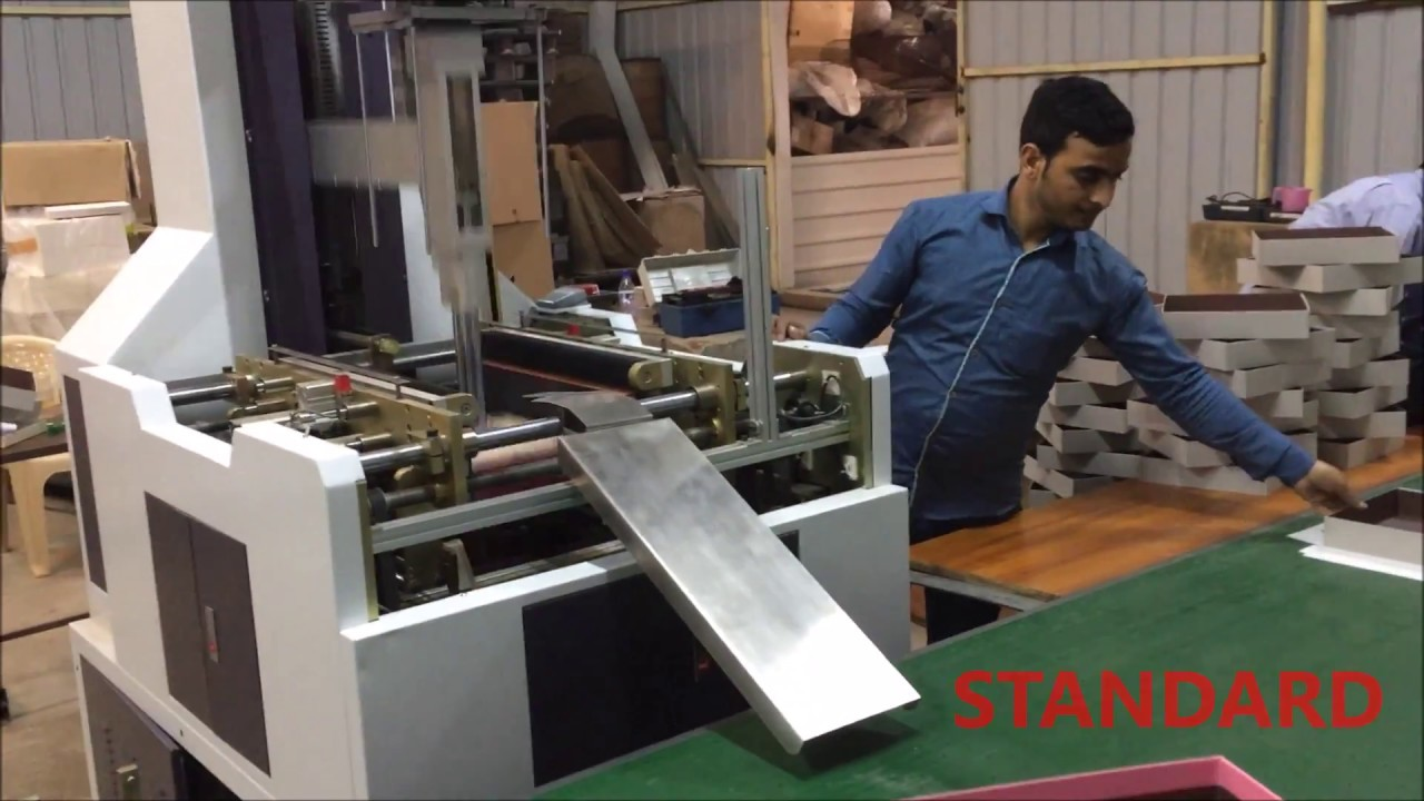 Rigid box making machine