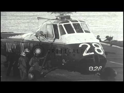 Australian personnel prepare to board a helicopter aboard Royal Australian Navy H...HD Stock Footage