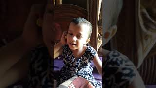 Funny baby talking over phone