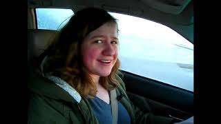 strong independant woman tries not to crash car while vlogging