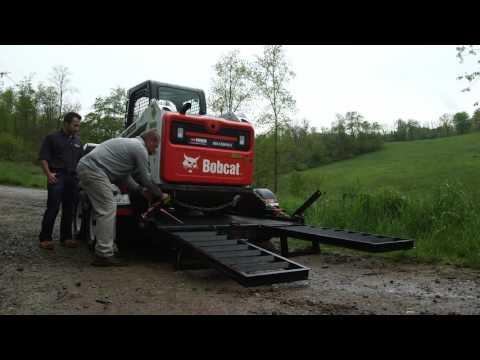 Taking The Bobcat Skid Steer Off The Trailer
