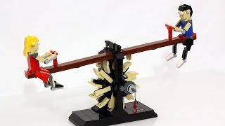 A kinetic LEGO sculpture of two children playing on a seesaw, or a ...