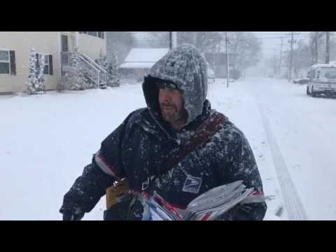 USPS mail carrier Ray Magnone delivers the mail on his Crans