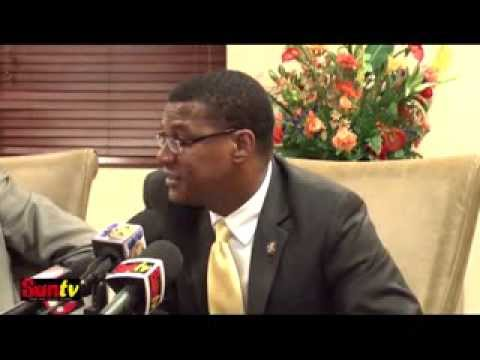 PREMIER EWING DEFENDS OVERSEAS TRAVEL BY MINISTERS