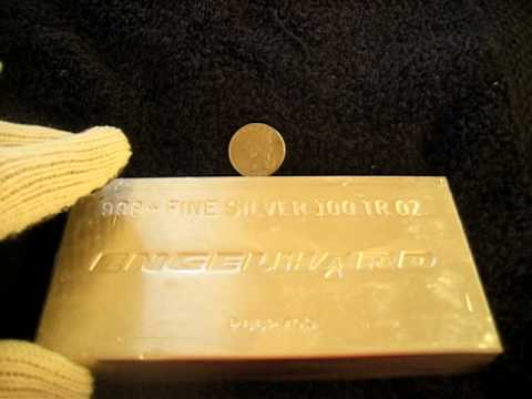 Comparing silver and gold  bullion to the size  of a regular quarter
