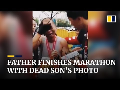 A father in China finishes marathon with dead son's photo, fulfilling promise