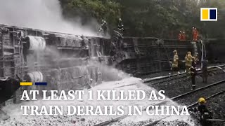 At least 1 killed and 127 injured as passenger train derails in China after hitting landslide