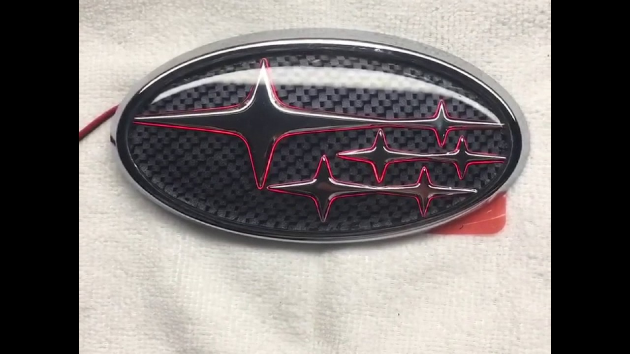 carbonfiber background with red led rear subaru emblem