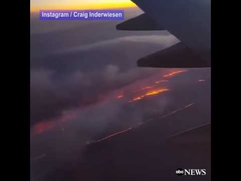 Wildfire from an airplane flying over the Oklahoma-Texas | firefighting