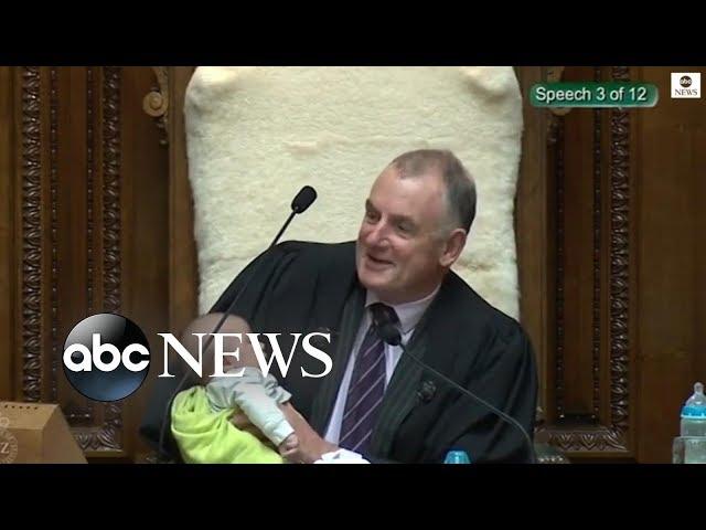 New Zealand parliament speaker cradles politician's baby during debate