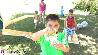 Biggest SLIP N Slide BaseBALL Game Party! Surprise Toys + Baseball Cookies Candy by HobbyKidsTV
