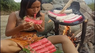 cooking in forest- grilled roasted crabs meatball on rock- eating delicious