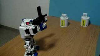 i sobot shoots miniature machine gun