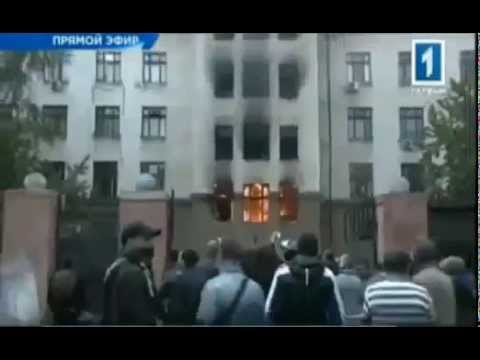 Odessa, Ukraine, 2.5.2014: People are jumping out of the window to rescue themselves