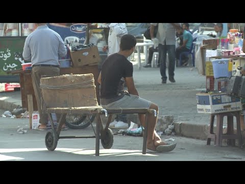 Focus - Economic slump weighs heavily on Tunisia's presidential election