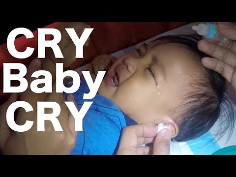Crying Baby Boy's Ear Cleaning using Bulb Syringe with Hydrogen Peroxide