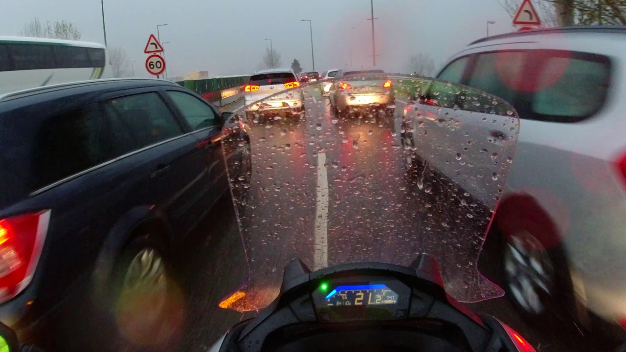 Going to Work on a heavy rainy day and heavy traffic - Honda NC 750S Integra - 4K UltraHD