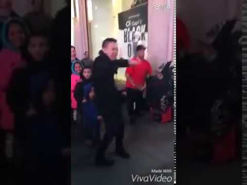 Asian guy forced to dance Gangnam Style in the public