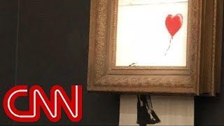 Watch Banksy's $1.4 million painting 'self-destruct'