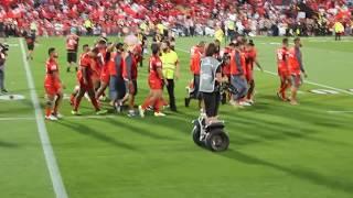 Tongan fans keep singing after loss.