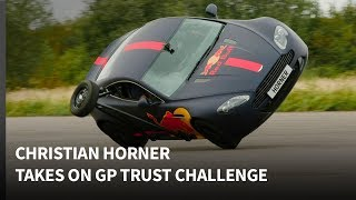Can Christian Horner drive an Aston Martin Vantage on two wheels? Grand Prix Trust Challenge