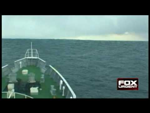 Japanese Coast Guard Rides 23 Foot Tsunami Wave