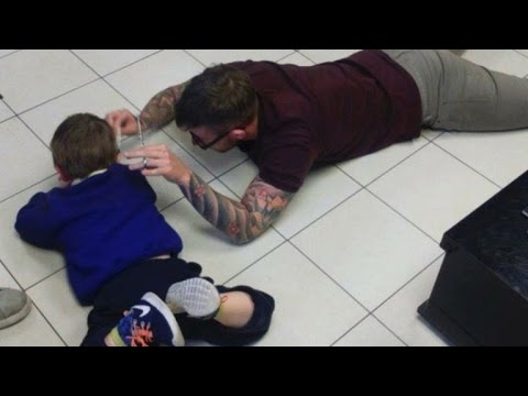Barber Lays On Ground To Give Boy With Autism Haircut