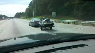 BMW 325i towing a Jetski
