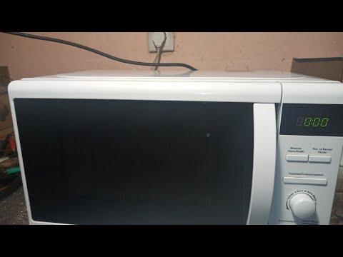 Искрит микроволновая печь  DELFA MD201DGW !