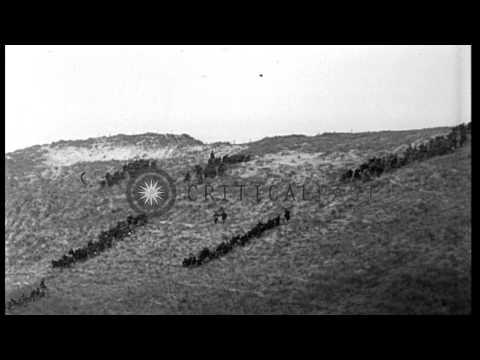 Belgian infantry attack across sandy terrain at Nieuport, Belgium, in World War I HD Stock Footage