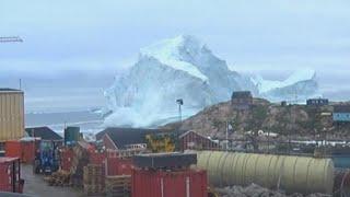Massive iceberg threatens Greenland village