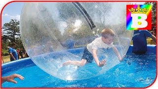 Giant WATER BALLS in a pool and inflatable DOLPHIN in Outdoor Playground ROSE VALLEY Fun Family Play